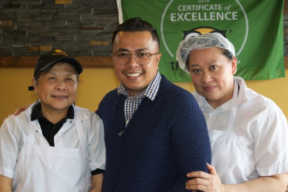 "Jatujak co-owner Phanom ""Patrick"" Suksaen and two kitchen staff members at the Birch Cliff location."